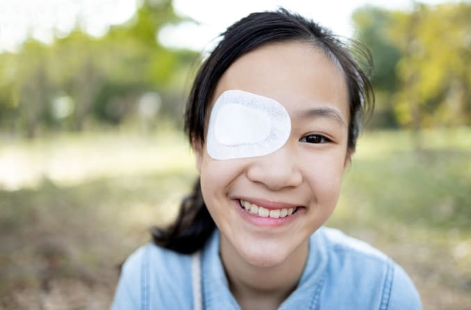 Girl wearing patch to treat amblyopia