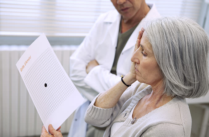 mature woman getting tested for macular degeneration