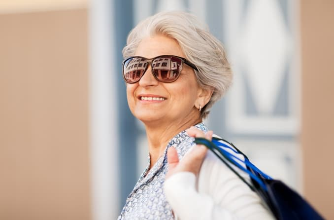 Smiling woman wearing classy oversized sunglasses