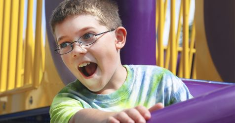 boy wearing polycarbonate lenses while riding a carnival ride