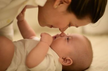 Mother and baby affectionately touching noses