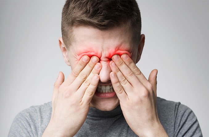 man with eyelid pain