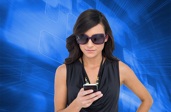 woman wearing sunglasses to protect her eyes from blue light on her mobile phone