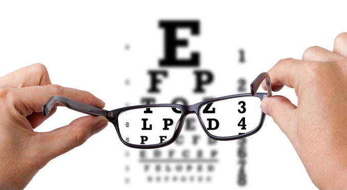 Looking at an eye chart through a pair of eyeglasses