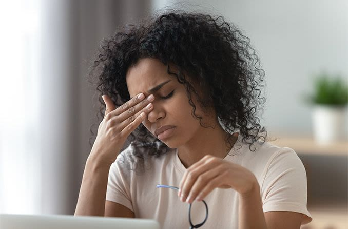 woman at computer with tired eyes