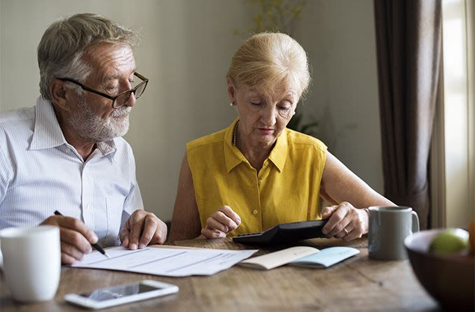 senior couple looking over vision insurance paperwork