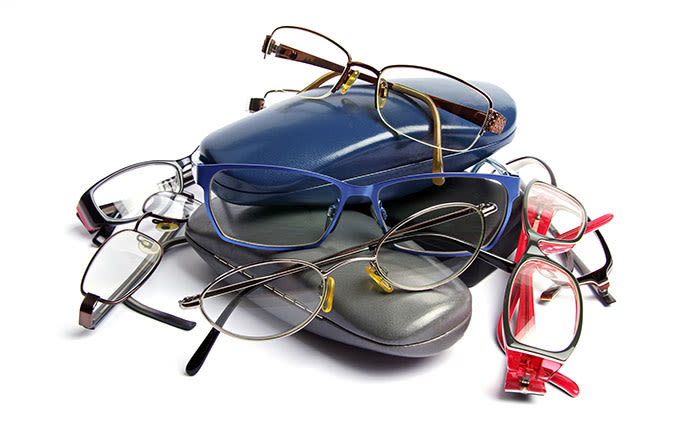 multiple colors and styles of reading glasses