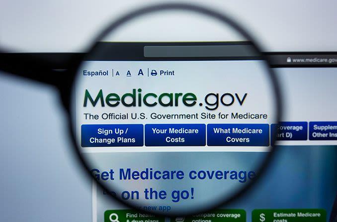 Medicare website looking through eyeglasses