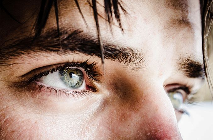 closeup of man with green eyes