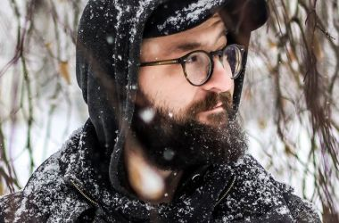 Man in snow wearing eyeglasses