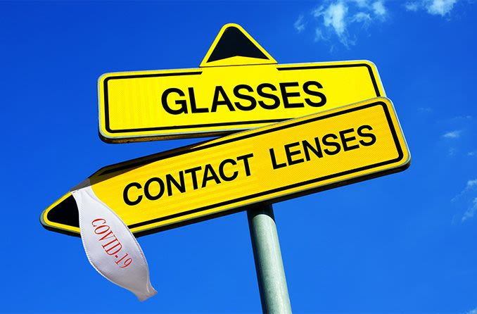 contacts vs glasses sign with covid-19 mask hanging from it