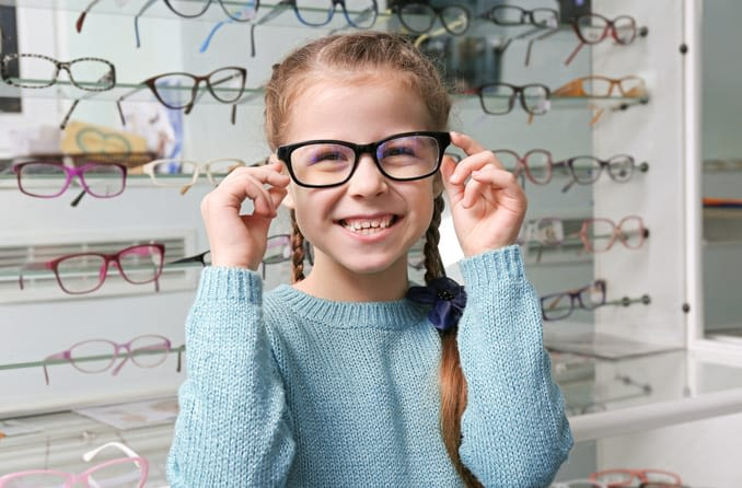 girl in glasses shop