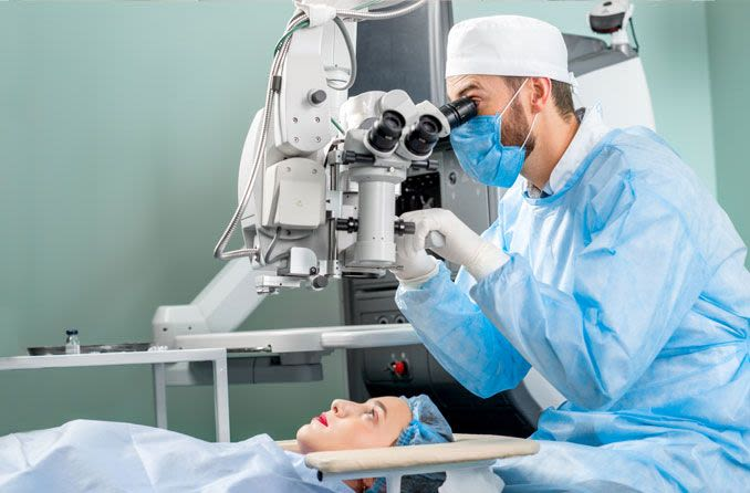 doctor performing laser cataract surgery on patient