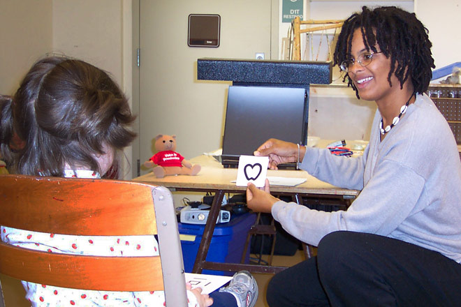 vision screener conducting test on child
