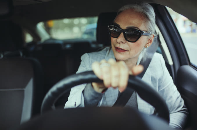 woman in sunglasses driving