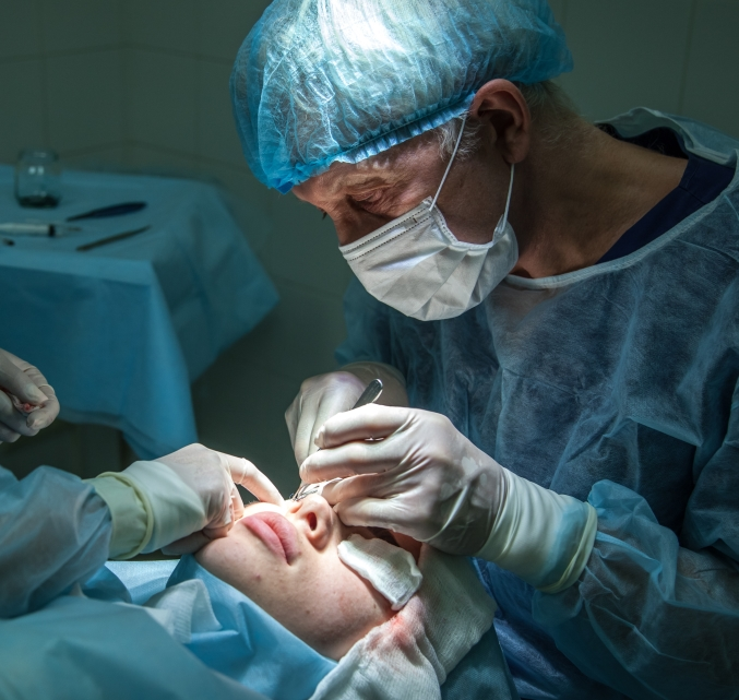 eye surgeon performing surgery