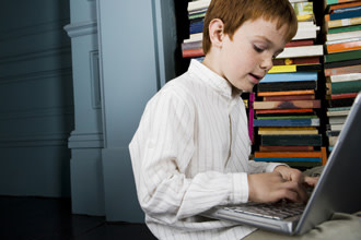 Boy using laptop, computer use