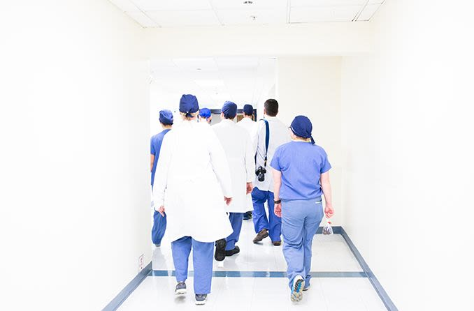 group of surgeons walking in hallway