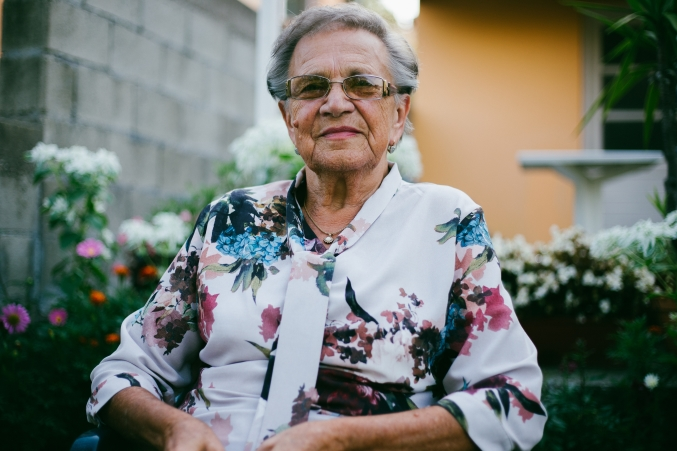 Senior woman outdoors wearing glasses