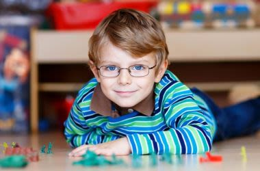 Young boy wearing glasses for myopia correction