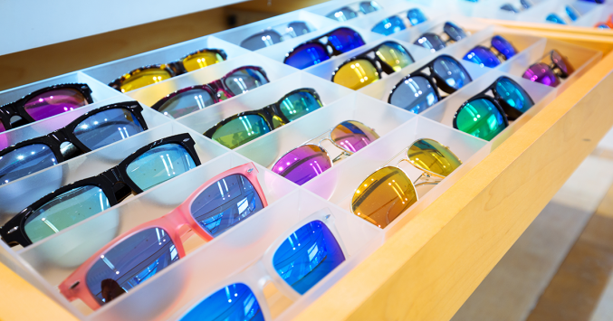 multiple sunglasses in a display case