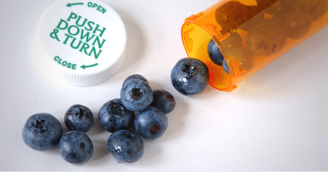 Blueberries in a pill bottle