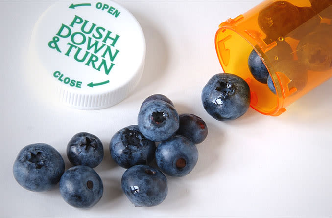 blueberries in a pill bottle for cataract nutrition