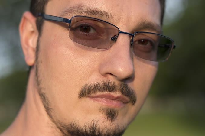 Man wearing photochromic lenses.