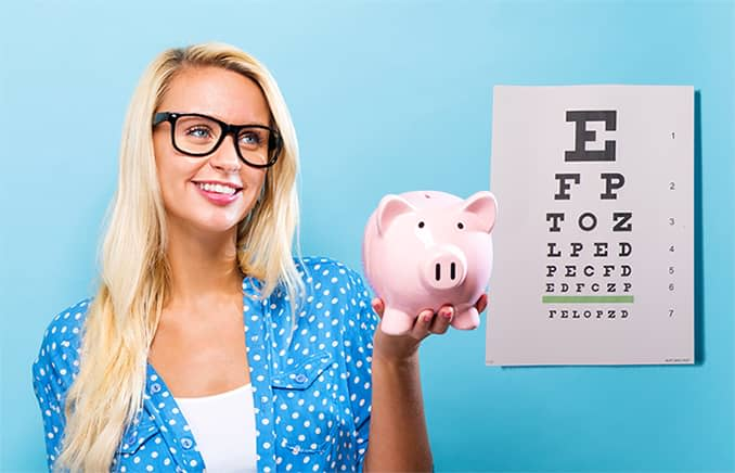 Woman looking at an eye chart and holding up a piggy bank wondering how much the eye exam cost