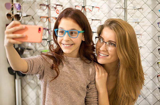 sisters taking selfies in their new eyeglasses