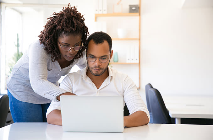 Couple looking on laptop for the best vision insurance plans
