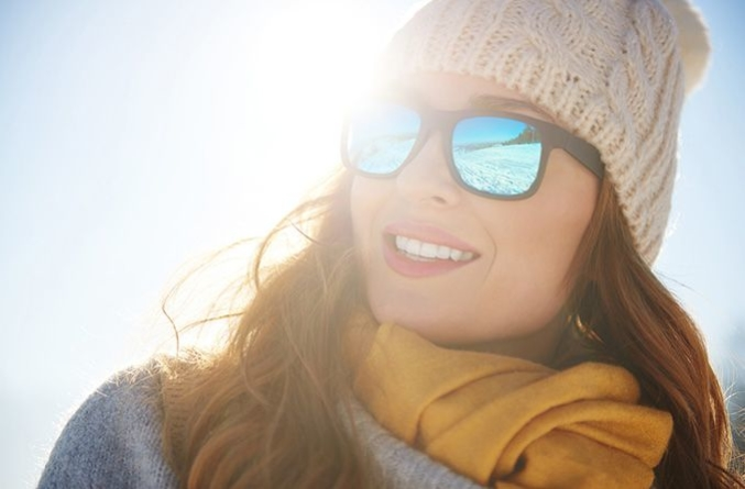 woman wearing sunglasses in the winter