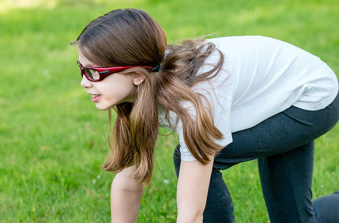 young girl wearing sports glasses outdoors