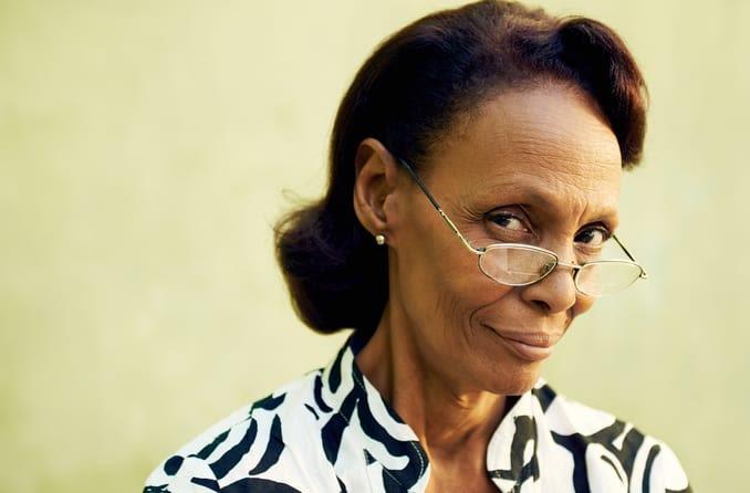 elegant older woman wearing glasses