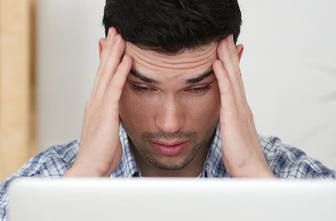 man with computer eye strain looking at laptop screen