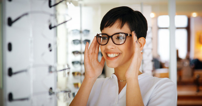 Woman trying on a pair of eyeglasses