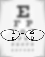 Eyeglasses in front of seeing chart