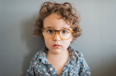 kid wearing glasses