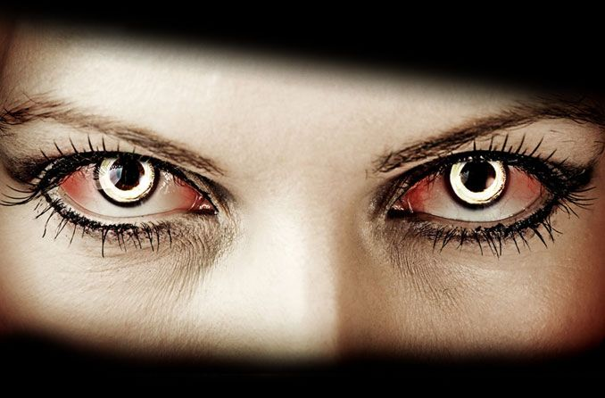 person wearing Halloween contact lenses