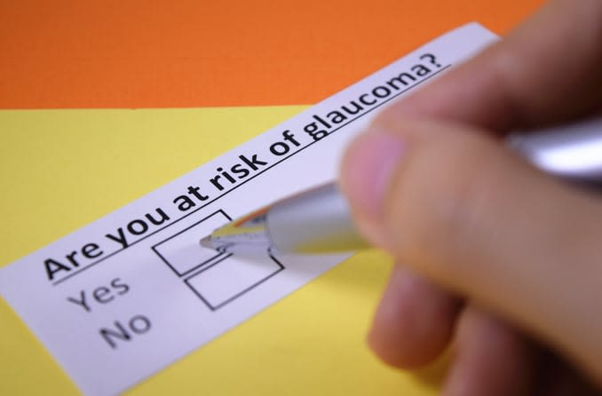 "Image of a slip of paper that says ""Are you at risk of glaucoma?"" with yes and no check boxes"