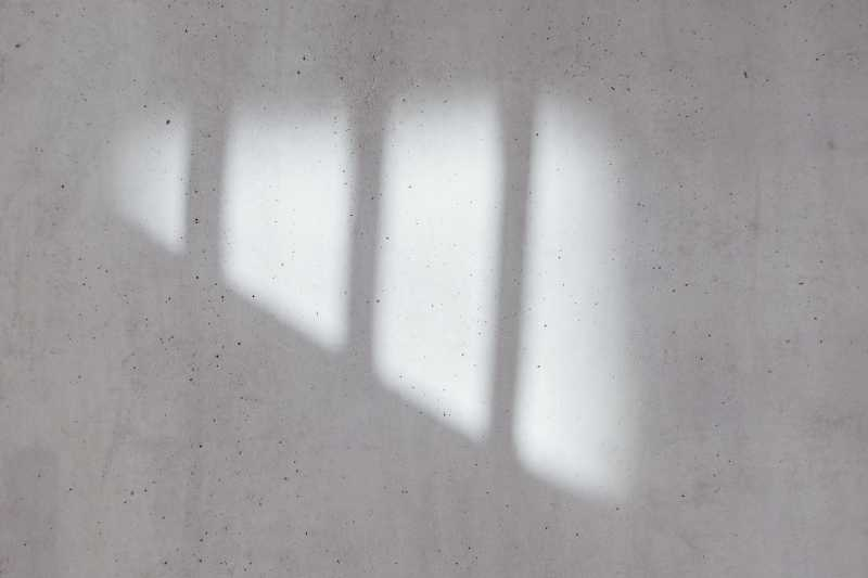 Light coming through a window and landing on a wall. Created by Bernard Hermant on Unsplash.