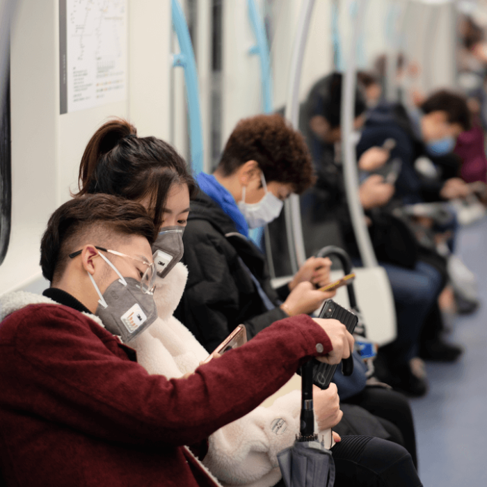 People traveling on public transportation wearing masks because of the coronavirus outbreak.