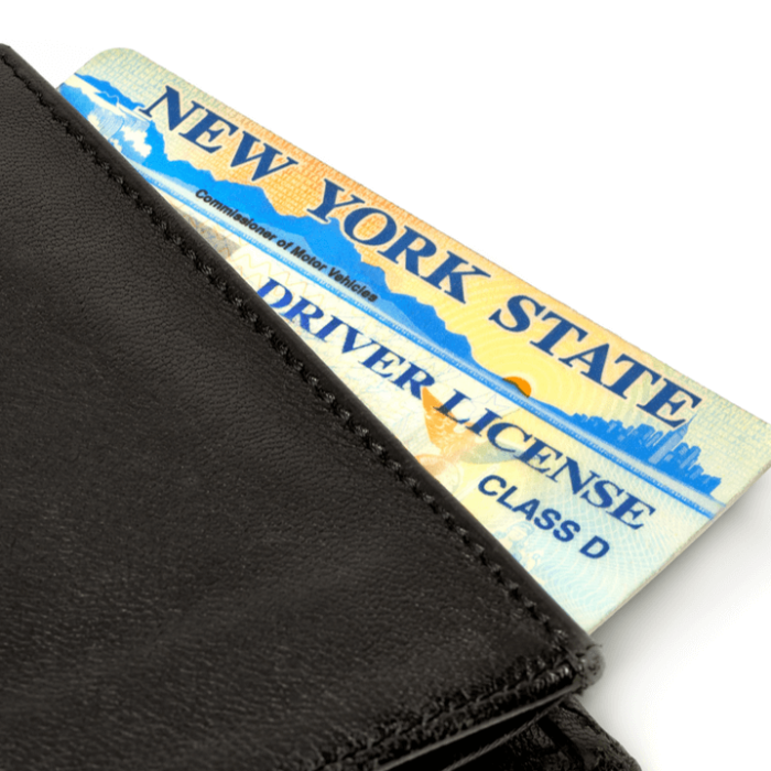 New York driver's license in a wallet