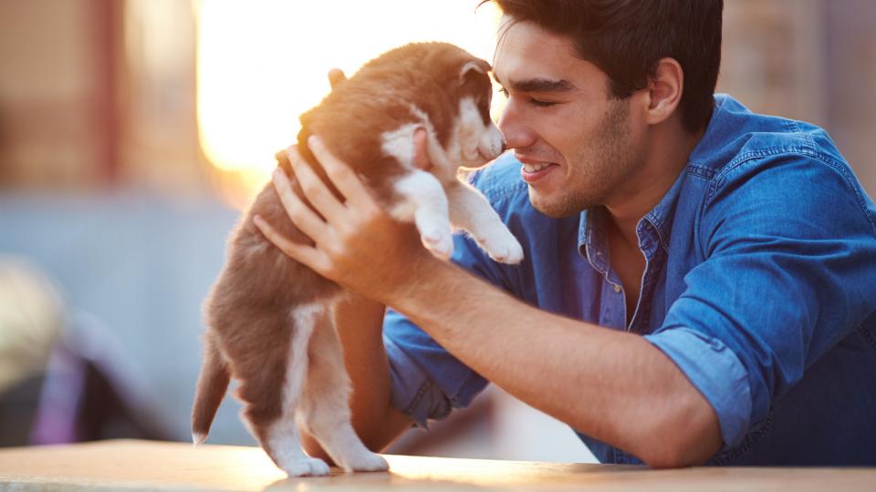 Man holding new puppy
