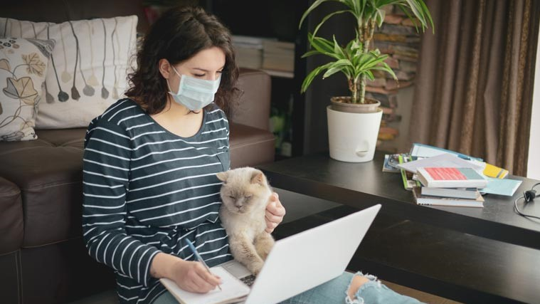 PPE with a cat, working from home