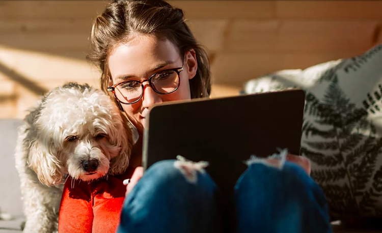 girl with dog on telehealth appointment
