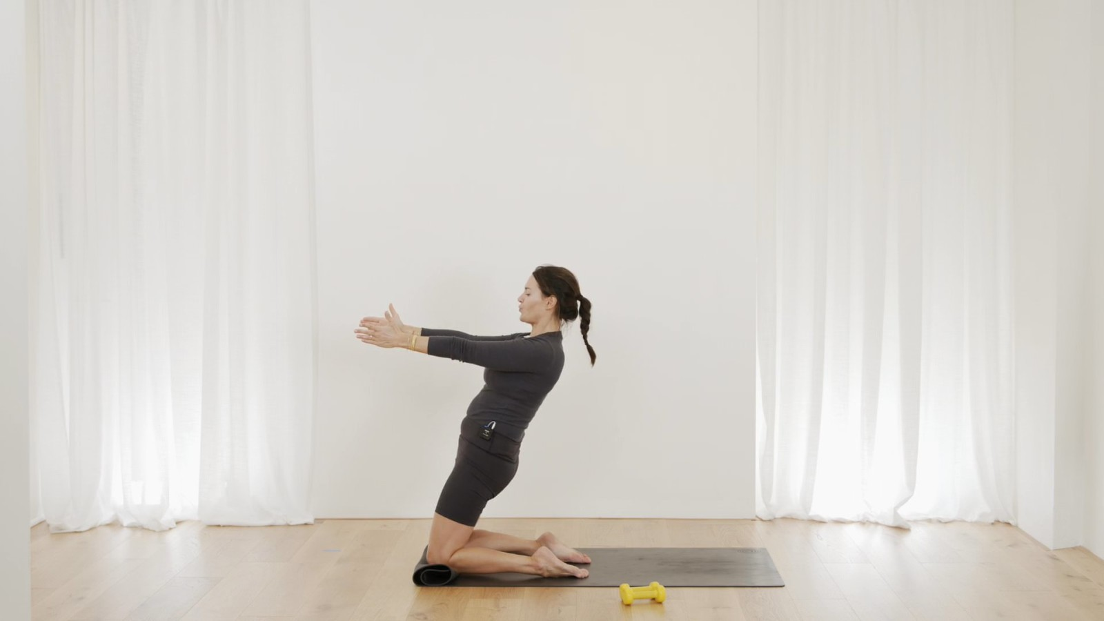 Traditional Pilates moves using dumbbells with Aneta Bachanova