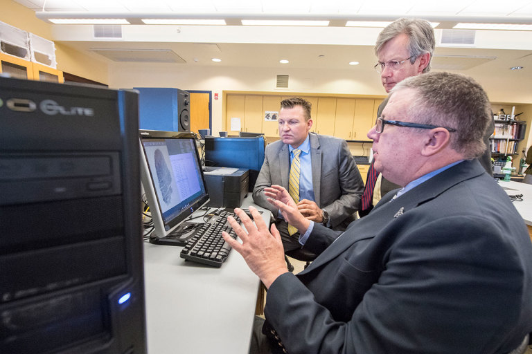 MorphoTrak representative discusses forensic databases with WVU officials