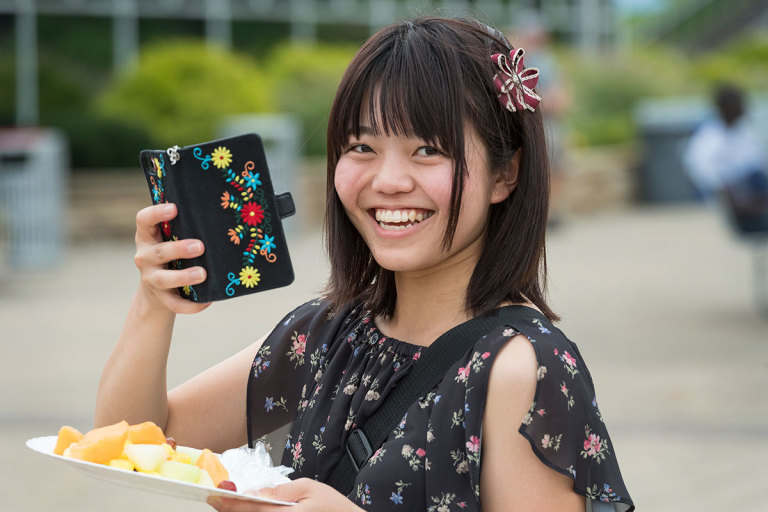 Student from Japan smiles for the camera at the International Students picnic