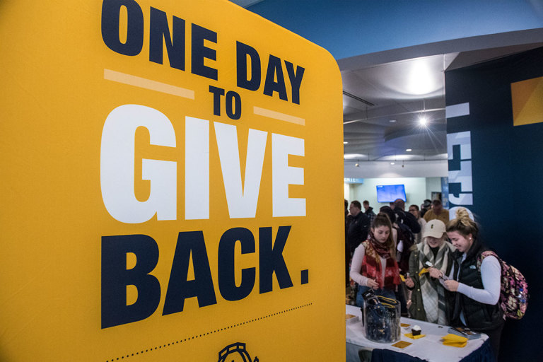 One Day to Give Back banner in the Mountainlair for Day of Giving